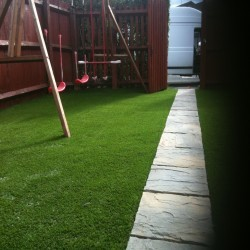 Artificial Grass Installation in Black Pole 5