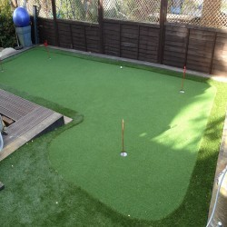 Artificial Grass Installation in Black Pole 10