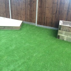 Artificial Grass Installation in Black Pole 4